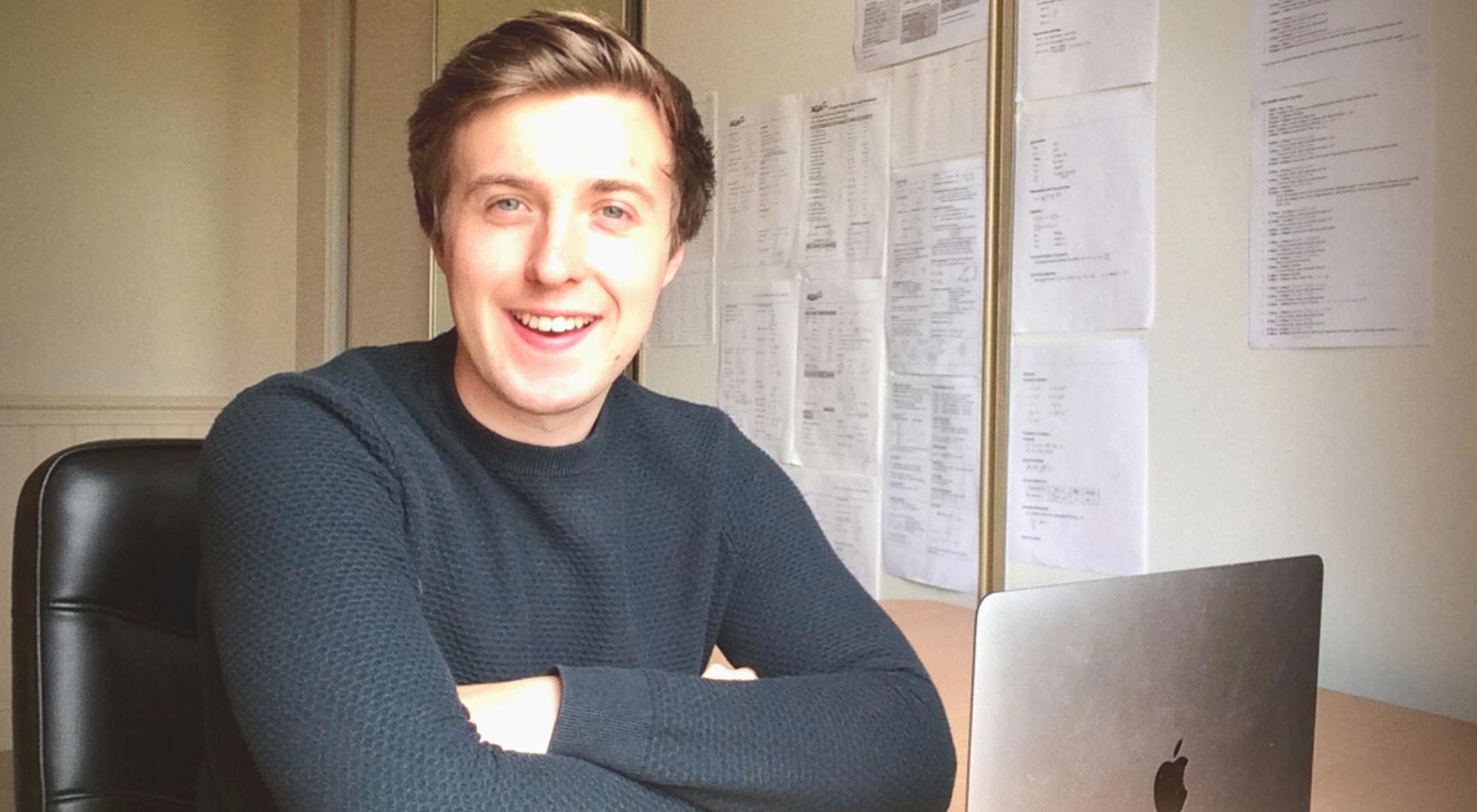 Gareth Evans sitting at desk